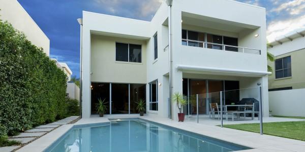 modern white villa with pool